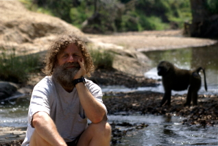 Robert Sapolsky and an olive baboon (courtesy of PBS)